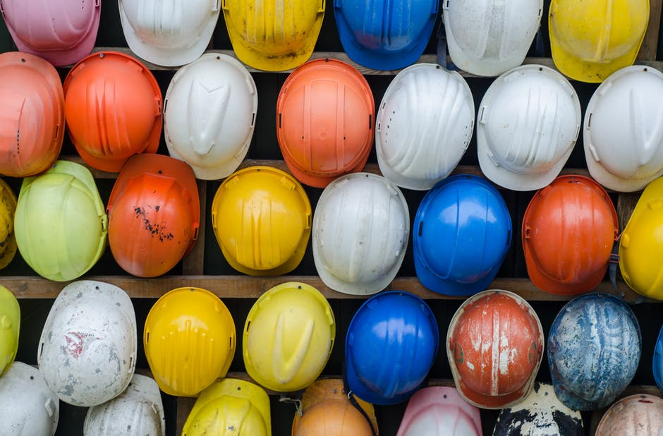 An arrangement of construction hardhats